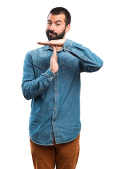 Man making time out gesture
