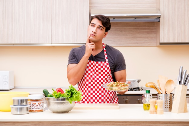 Man male cook preparing food in kitchen