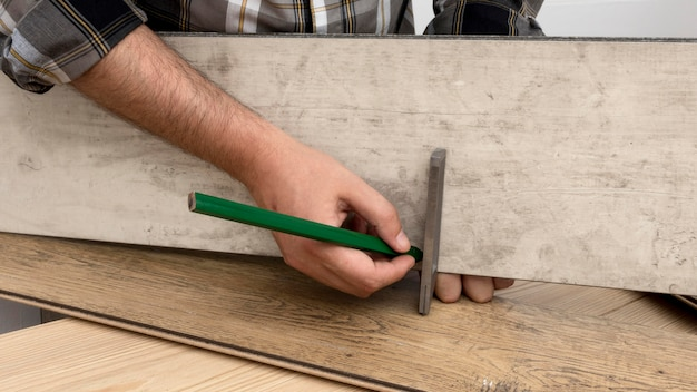 Man measuring carpentry workshop concept
