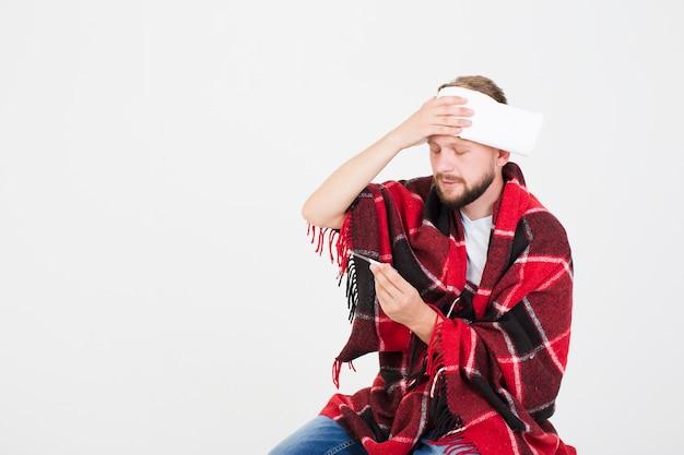 Man measuring temperature