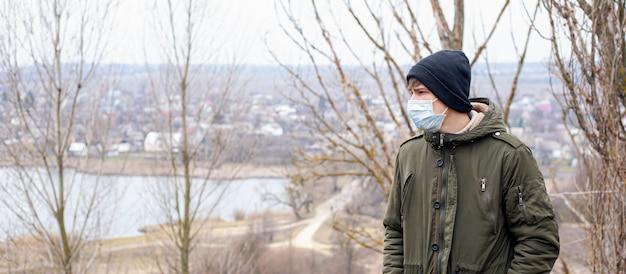 Man in medical mask concept quarantine. epidemic, pandemic, viral infection. coronavirus covid-19.
