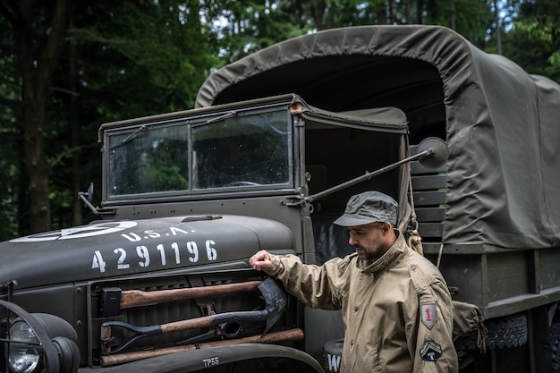 Man in a military uniform in an army car.