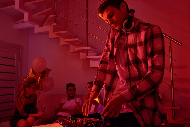 Man mixing music on christmas party