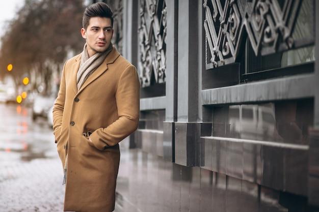 Man model in coat outside