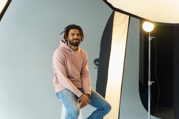 Man model sitting on chair