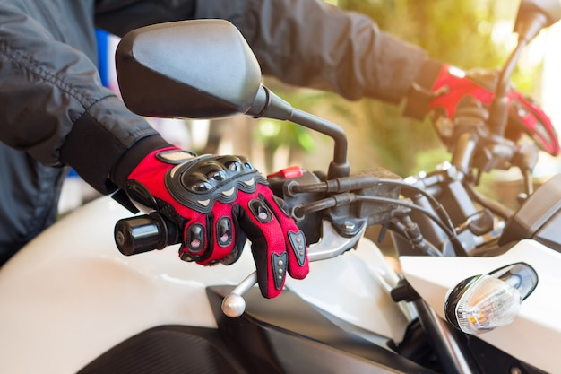 Man in a motorcycle with gloves is an important protective clothing for motorcycling