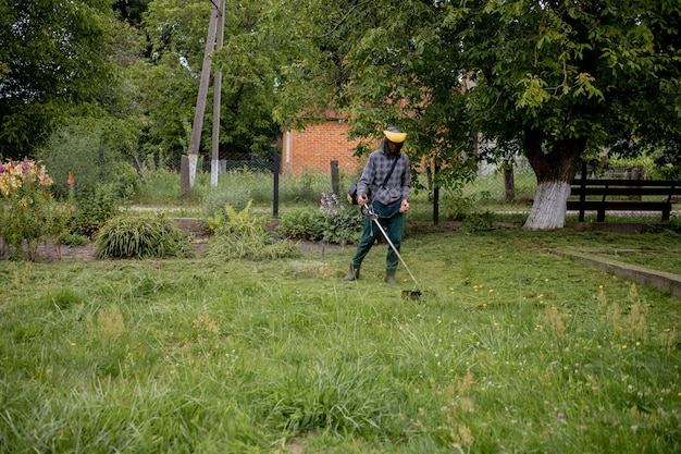 Man mowing the lawn in his garden. gardener cutting the grass. lifestyle.