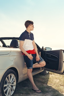Man near cabriolet car outdoors