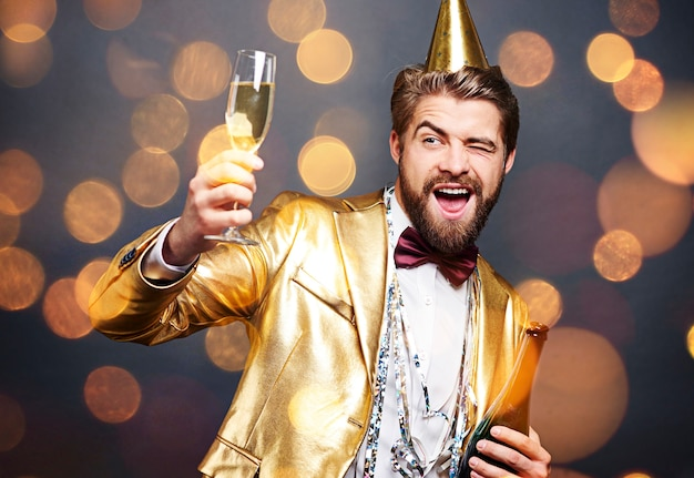 Man offering champagne and flirting at party