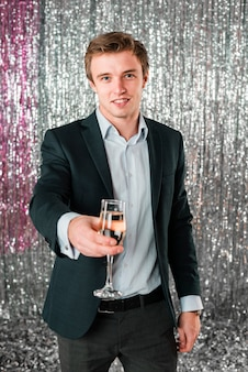 Man offering drink new year party