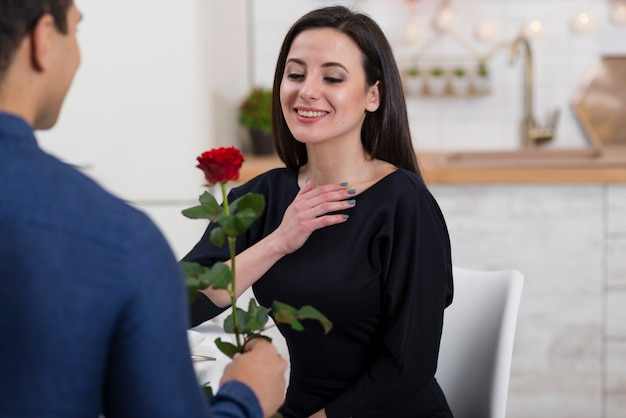 Man offering his girlfriend's a rose