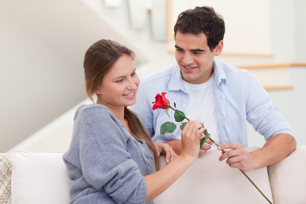 Man offering a rose to his fiance