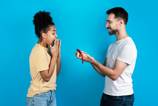 Man offering woman gift box