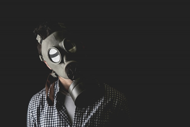 Man in the old military gas mask, escaping the reality of the duties of managerial life.