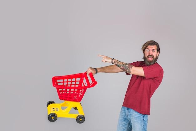 買い物の男スーパーマーケット買い物セール割引ブラックフライデー買い男買い物買いまくる