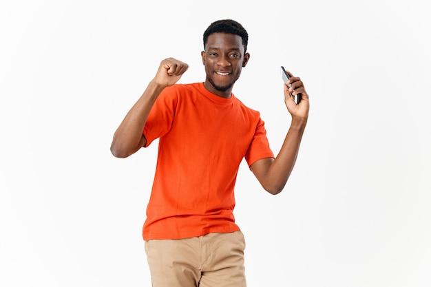 Man in orange tshirt combing hair