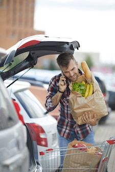 Man packing groceries