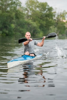 Man paddling rowing concept