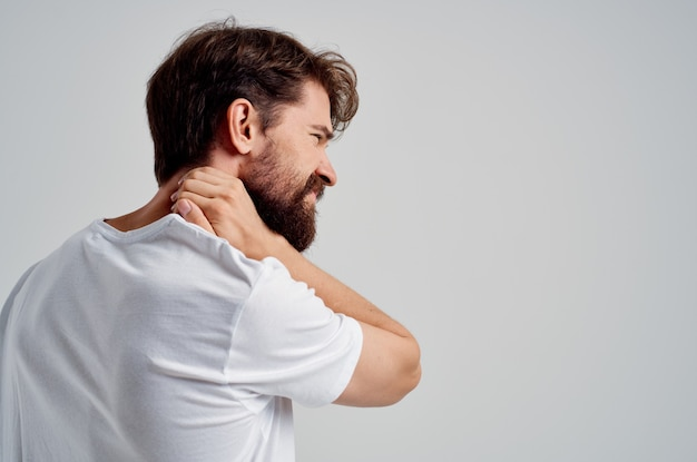 Man pain in the neck health problems massage therapy studio treatment