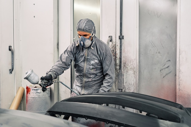 A man painting a car