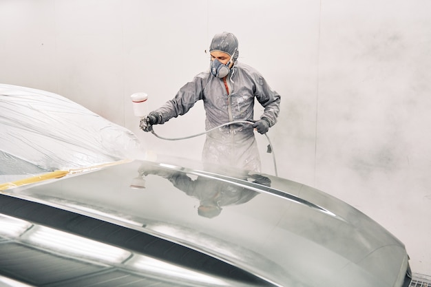A man painting a car
