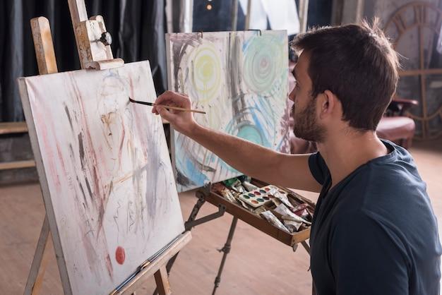 Man painting at home