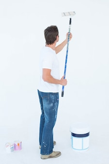 Man painting on white background