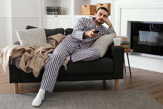 Man in pajamas watching tv