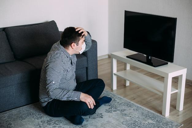 Man in panic watching tv news