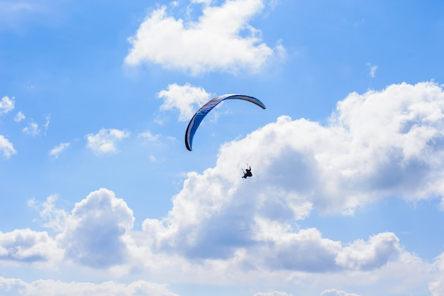 Man on a parachute flying in the clear sky