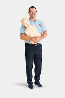Man paramedic cpr dummy mannequin medication concept