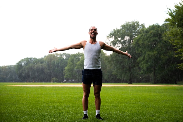 Man in park with arms wide open