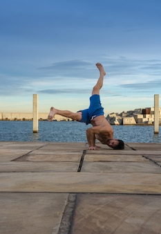 Man performing advanced yoga exercises and stretching.