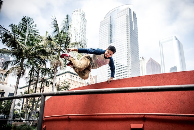 Man performing parkour tricks in the urban center