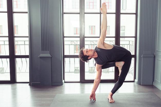 Man performing yoga indoors