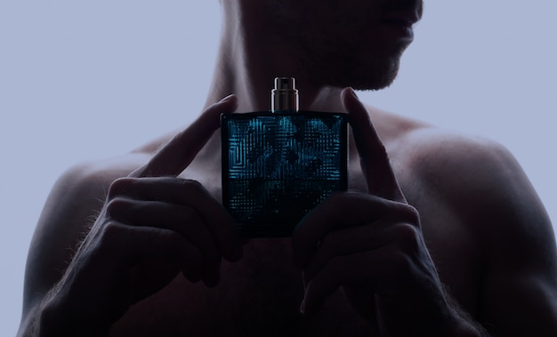 Man and perfume on blue