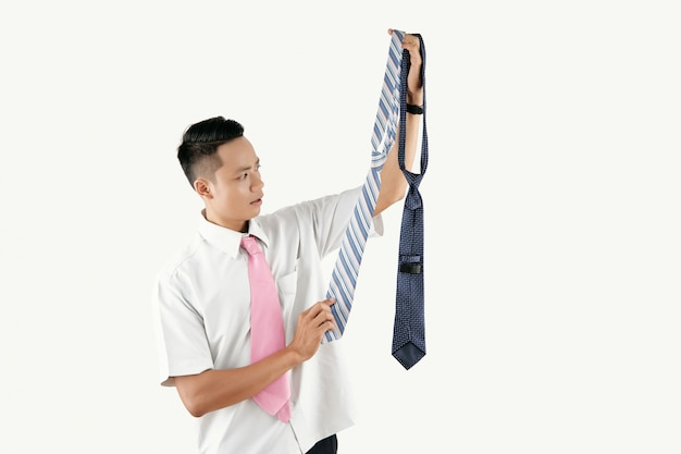 Man picking necktie