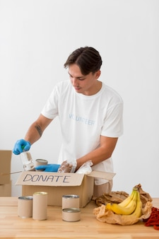 Man placing goodies in donation boxes
