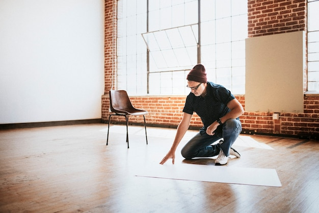 Man planning a project on a wooden floor