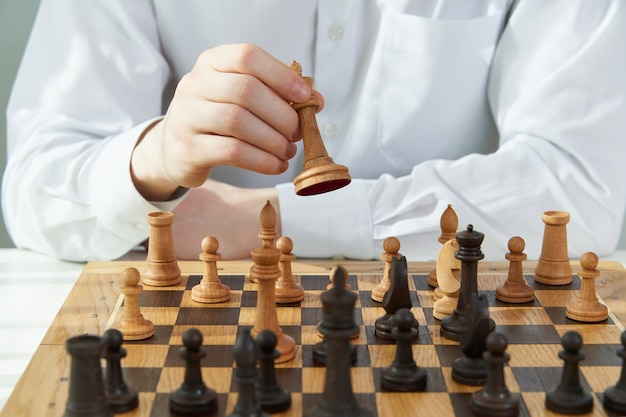 Man play chess during quarantine due to coronavirus pandemic
