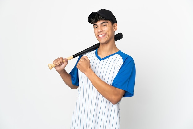 Man playing baseball over isolated white background celebrating a victory