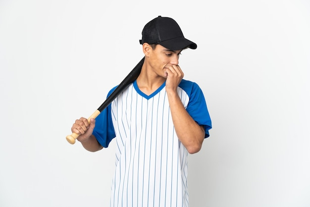Man playing baseball over isolated white background having doubts