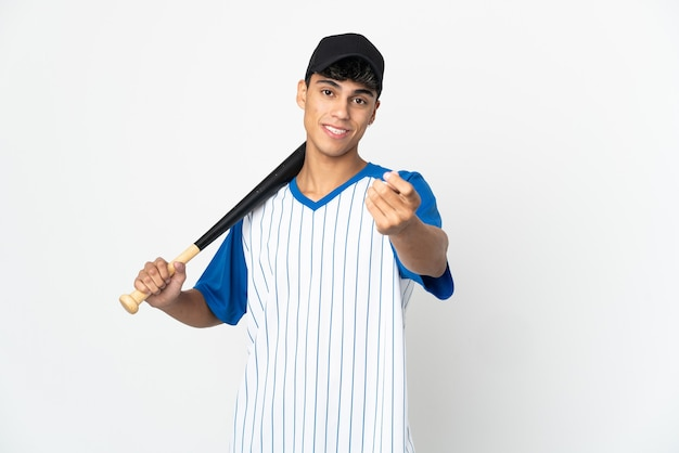 Man playing baseball over isolated white background making money gesture