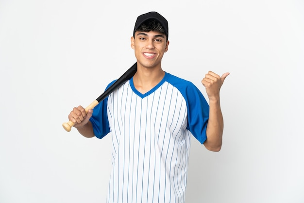 Man playing baseball over isolated white background pointing to the side to present a product