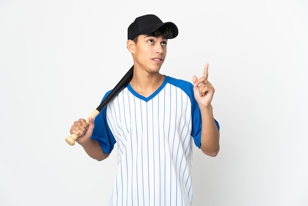 Man playing baseball over isolated white background pointing up a great idea