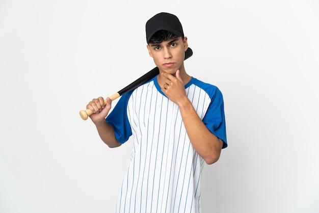 Man playing baseball over isolated white background thinking