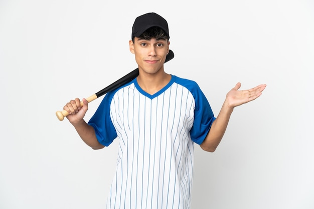 Man playing baseball on isolated white having doubts while raising hands