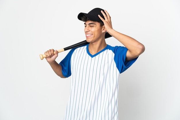 Man playing baseball over isolated white smiling a lot