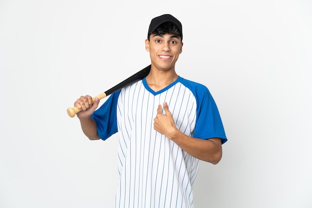 Man playing baseball over isolated white wall with surprise facial expression