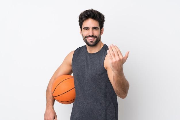 Man playing basketball over isolated wall